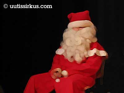 joulupukki istuu, tausta musta