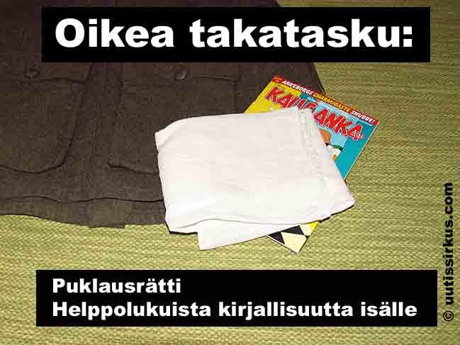 puklausrätti ja Kalle Anka -lehti sarkatakin oikean takataskun päällä