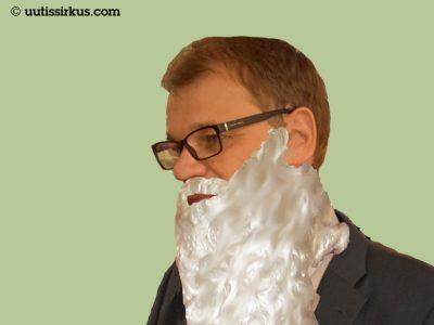 pääministeri Juha Sipilä joulupukin parrassa