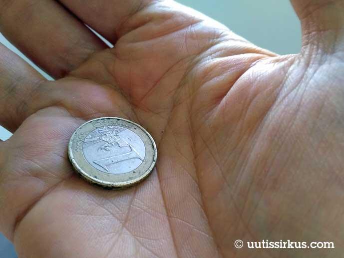 euron kolikko mihen kädessä